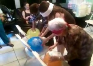 funny baby shower games tie the diaper to the baby