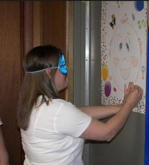 pin the pacifier baby shower games